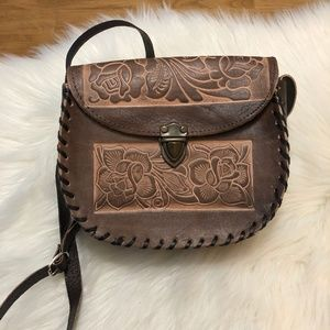 Vintage handmade tooled leather cross body.